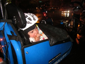 Even with our efforts to pack her in under a rain skirt, our preschooler was not enjoying this ride on the Bullitt.