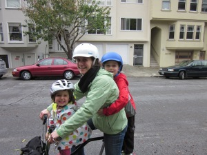 Yep, that's two kids on one Brompton bicycle. We are our own clown car.