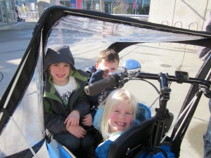 Loading up: three kids in the box of our Bullitt bicycle.
