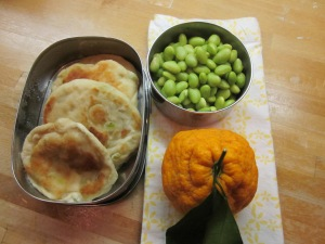 One of Matt's lunches: green onion pancakes, beans, orange