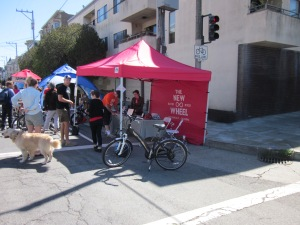 The New Wheel was giving test rides at Western Addition Sunday Streets--they must be doing a land office business.
