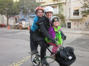 Moving up: two kids on a Brompton, now aged 8 and 4