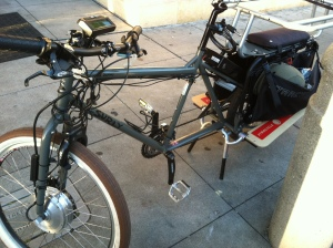 This Surly has the motor on the front wheel, along with the clever wheel lock.