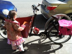 Bakfiets short from My Dutch Bike, which I am discouraging my daughter from climbing into when this photo was taken