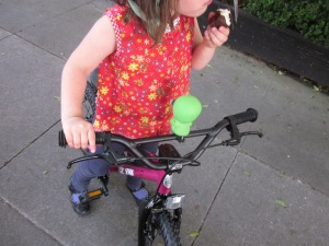 Check out those handlebars: front and rear brake! She can stop while eating a cupcake.