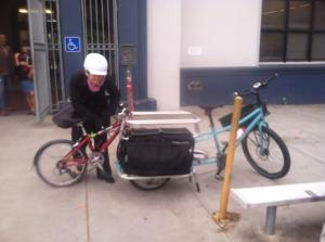 Loading up my son's bike for the tow.