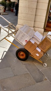 This is a Venetian handtruck: pull it up the stairs and the load stays steady, then flip it around and bounce it down.