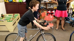My son, in love with one of G&O's many kid bikes