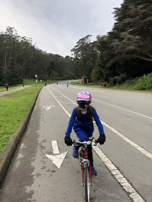 Girl riding bicycle in Golden Gate Park